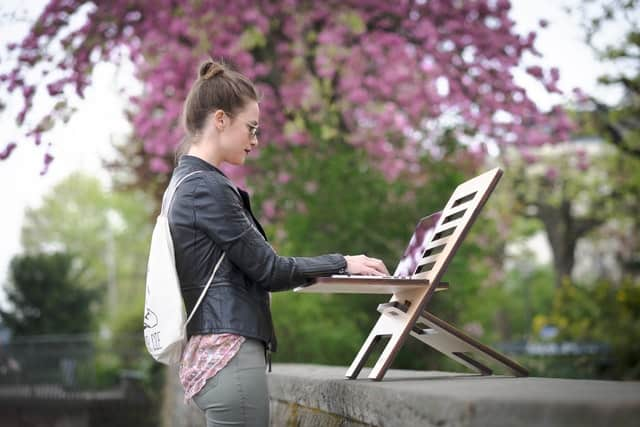 Woman working on what is copywriting outdoors
