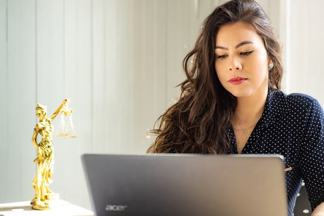 Image of woman on laptop discovering what is copywriting