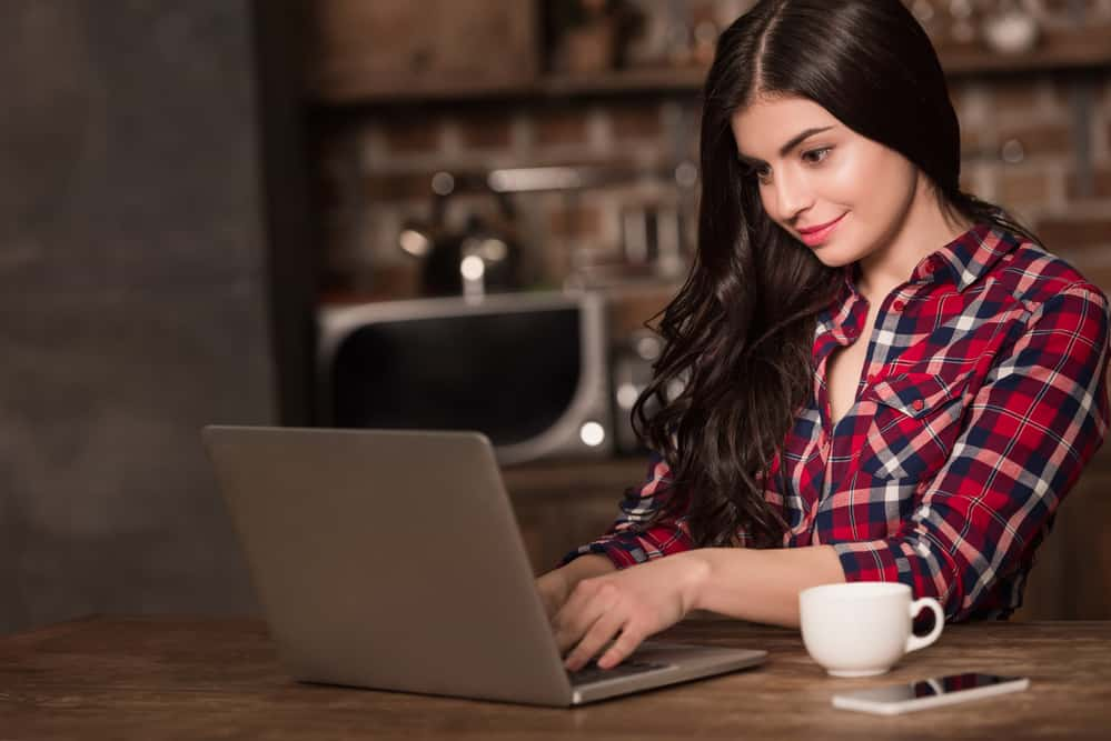 Image showing what is seo writing with girl working on laptop